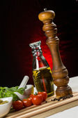 Pepper mill and fresh vegetables — Stock Photo