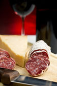 Salame, cheese and red wine — Stock Photo