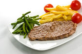 Steak with fries — Stock Photo