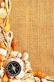 Kompas na mušli a lana rámeček na pytel — Stock fotografie