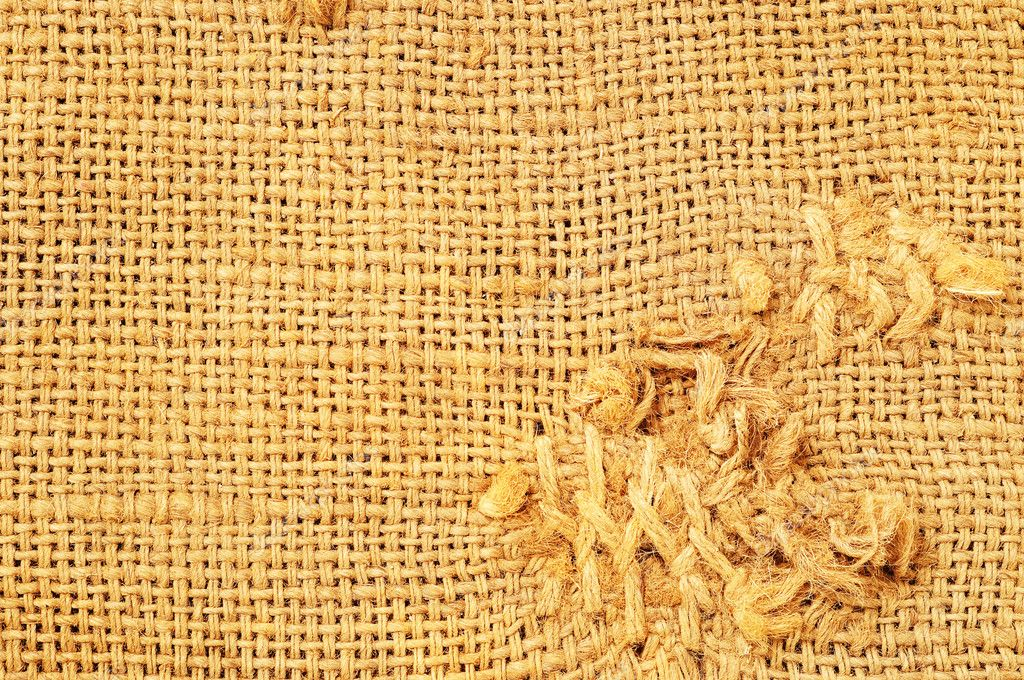 Brown thread that executes the stitches on sacking — Stock Photo #9615792