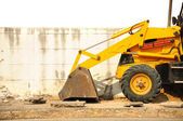 Wheel loader machine on the road — Stock Photo