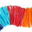 Colorful ropes on white background - Stock Photo