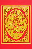 Golden dragon decorated on red wood — Stock Photo