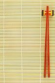 Chopsticks on bamboo background — Stock Photo