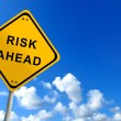 Risk ahead traffic sign on bluesky — Stock Photo