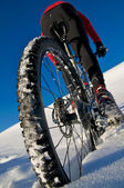Winter Biking on snow-covered Austrian mountain — Stock Photo