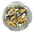 Stock Photo: Ashtray full of cigarette butts
