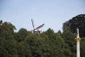 Mill in trees — Stock Photo