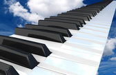 Piano flying in the sky. — Stock Photo