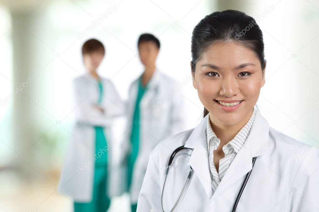 Female doctor with colleague in the background out of focus. — Stock Photo #10353598
