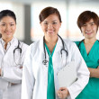 Stock Photo: A team of a happy Doctors