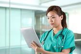Portrait of a Female doctor holding a digital tablet. — Stock Photo