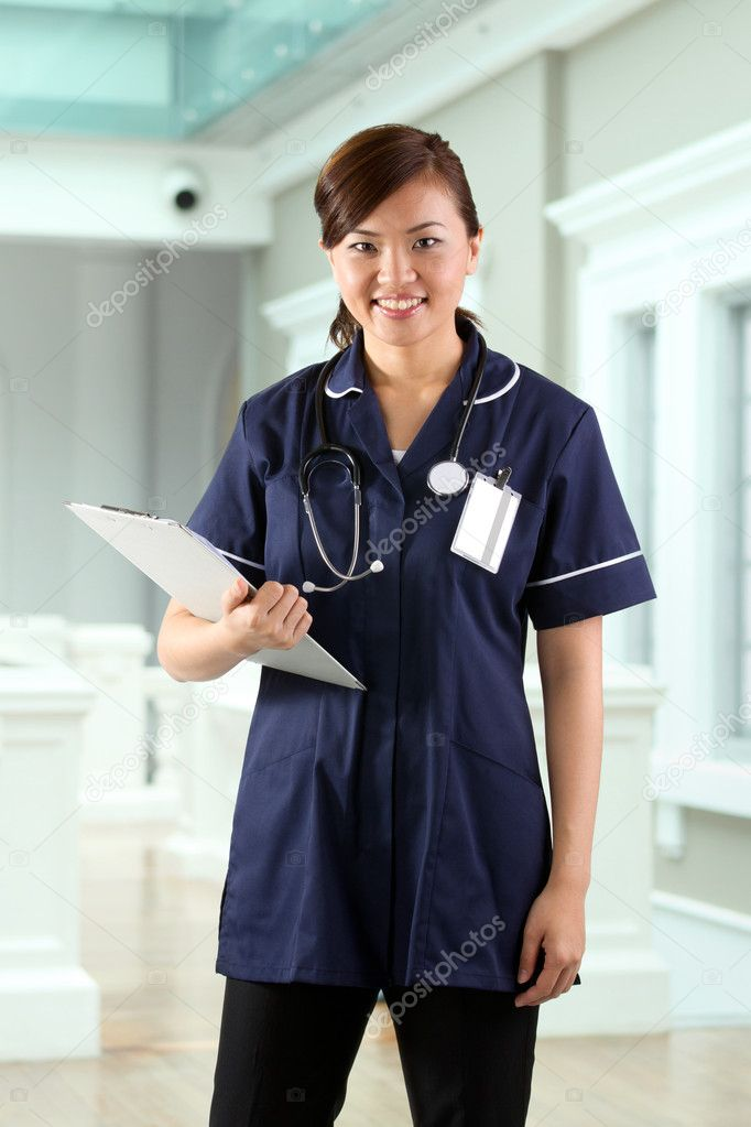 Young Asian Female Nurse holding a stethoscope. — Zdjęcie stockowe #10365741