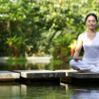 Asian Woman performing yoga — Stock Photo