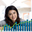 Businesswoman with finance chart - Stock Photo