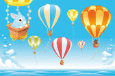 Hot air balloons in the sky on the sea with bunny. — Stock Vector
