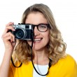 Beautiful young girl with camera — Stock Photo #10044776