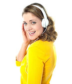 Attractive teenager tuned into music — Stock Photo