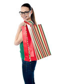 Side view of woman holding shopping bags — Stock Photo
