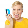 Blond sales girl posing with credit card — Stock Photo #10090625