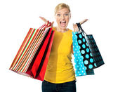 Young woman excited after tons of shopping — Stock Photo