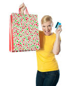 Shopaholic teenager posing in excitement — Stock Photo