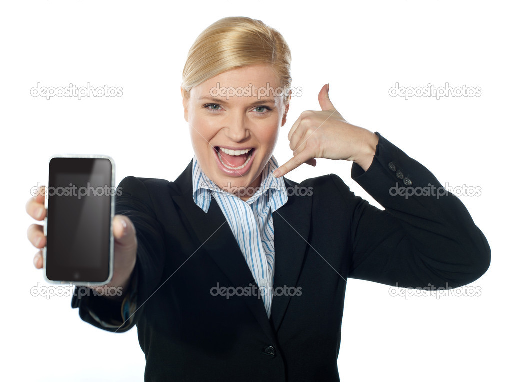 Saleswoman displaying iphone to camera, based on touch-pad technology — Stock Photo #10090737