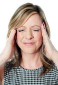 Woman having a bad headache — Stock fotografie