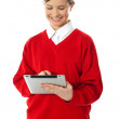 School girl using new touch pad device — Stock Photo #10223935