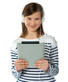 Smiling pretty girl holding i-pad — Stock Photo