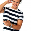 Portrait of a young man using mp3 player — Stock Photo