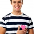 Casual man with a paper heart - Lizenzfreies Foto