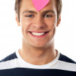 Closeup of an attractive man with paper heart - Lizenzfreies Foto