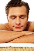 Attractive man resting with closed eyes at spa — Photo