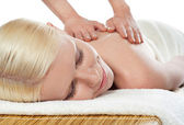 Attractive young spa lady getting a massage — Stock Photo