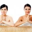 Pretty ladies in traditional welcoming gesture — Stock Photo