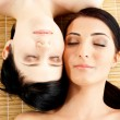 Massage of two beautiful females in spa salon — Stock Photo
