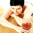 Spa woman relaxing with a wine glass beside her — Stock Photo