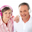 Cute senior couple listening to music together — Stock Photo