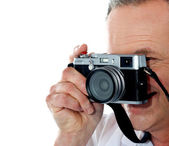 Cropped image of aged male photographer — Stock Photo