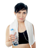 Young sporty woman with towel isolated — Stock Photo