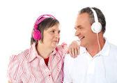 Romantic senior couple enjoying music together — Stock Photo