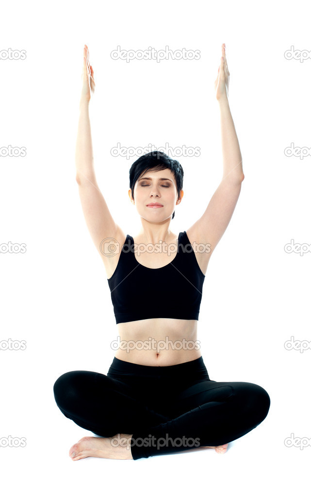 Portrait of beautiful young woman doing yoga exercise. Arms raised — Stock Photo #10619074