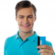 Close-up portrait of fashionable guy holding debit card — Stock Photo