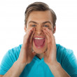 Exciting young handsome man shouting — Stock Photo #9672736
