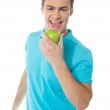 Handsome young caucasian biting an apple — Stock Photo #9672739