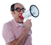 Senior casual male with megaphone — Stock Photo