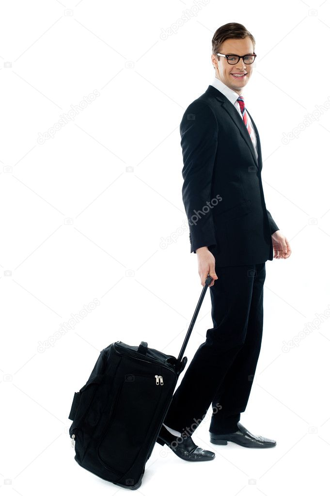 Corporate person leaving for business meeting as he drags his luggage  Stock Photo #9673034
