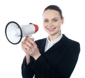 Attractive woman with megaphone — Stock Photo
